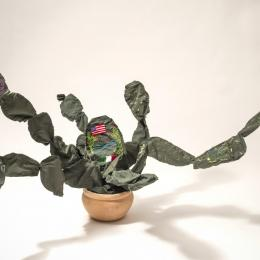 "Margarita Cabrera, Mexican, b. 1973, ""Space in Between - Nopal #3,"" 2012. Border patrol uniform fabric, thread, copper and terra cotta pot. 41 x 59 x 34 in. Purchased with funds provided by the Windgate Charitable Foundation 2012.047.001"