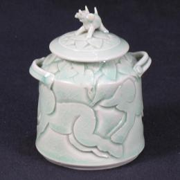 Coille McLaughlin. Hooven, American, b. 1939. Green Lidded Pot with Elephants Hand built and carved porcelain. 4 3/8 x 2 3/4 x 3 3/8 in. Gift of Mitzi D. Schoninger. 1992.125.000. Open Storage Room (Ceramics Center), Tiers29, Shelf 02 (20 Apr 2012)