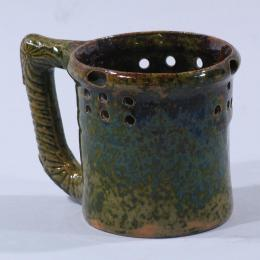 George E. Ohr, American, 1857 - 1918. Mug, 1896. Ceramic. 4 5/8 x 3 5/8 in. Collection of Stéphane Janssen and R. Michael Johns. 2005.069.052. Prop Storage Room 44, Tier B, Shelf 02 (8 Mar 2012)