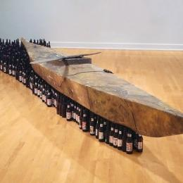 "Kcho, ""Para olvidar (In Order to Forget)"", 1996. Kayak and beer bottles. 270 x 138 in. Purchased with funds provided by the ASU Art Museum Store; the Friends of the ASUAM; and by The FUNd at Arizona State University Art Museum"