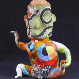 Michael Lucero, American, b. 1953. Anthromorphic Teapot (New World Series) Form with Blond Hair, 1991. Earthenware with glazes 16 1/2 x 14 x 6 1/2 in. Gift of Anne and Sam Davis. 1998.228.000. Open Storage Room (Ceramics Center), CC Tiers 31, Shelf 01 (1 Mar 2014)