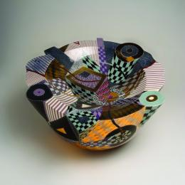 Ralph Bacerra, American, 1938 - 2008. Vessel/Violet, 1988. Whiteware with violet, gold, black & white checkered patterns with red. 11 1/2 x 22 in. Museum purchase through a gift from the Stéphane Janssen Art Foundation. 2001.034.001. Prop Storage Room 44, Tier F, Shelf 04 (3 Oct 2014)