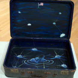 "Sandra Ramos, ""De la serie Migraciones II (nadando bajo las estrellas)"" (From the series Migrations II [Swimming Under the Stars], 1994. Oil on suitcase. 19 1/2 x 25 x 17 in. Gift of the ASU Art Museum Advisory Board 100% Cuban Campaign"