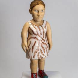 Claudette Schreuders, South African, b. 1973, New Red Shoes, 2003‑2004. Jacaranda wood, enamel paint. 30 1/2 x 12 x 9 3/4 in. Museum purchase with funds provided by the Windgate Charitable Foundation 2004.005.001