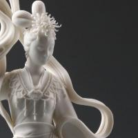 Porcelain sculture of asian woman with flowing cloth pieces entitled Chang'e's Ascent to the Moon by Xu Rei-feng